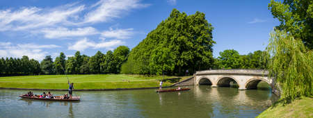 A panoramic view of the River Cam and Trinity Bridge in Cambridge, UK.