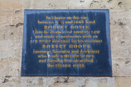 discovered: OXFORD, UK - AUGUST 12TH 2016: A plaque on the High Street in Oxford marking the location where Robert Boyle discovered Boyles Law, taken on 12th August 2016. Editorial