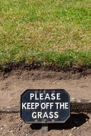 stay in green: A polite sign warning people to Keep off of the Grass.