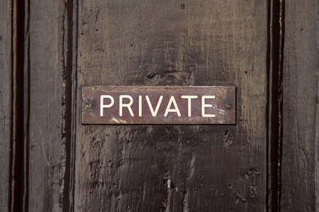 trespass: A Private Sign on a doorway.