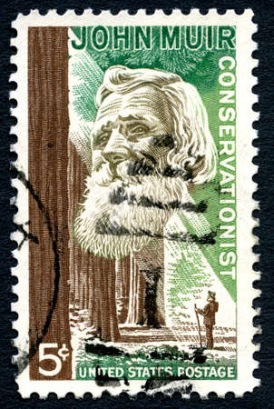 muir: UNITED STATES OF AMERICA - 1ST MARCH 2016: A used postage stamp printed in America (circa 1964), depicting an image of Naturalist and Conservationist John Muir, circa 1964.