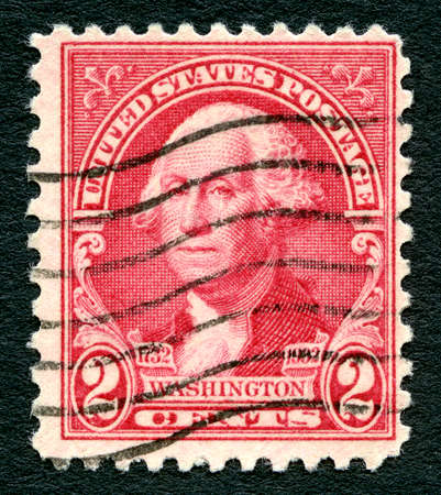 george washington: UNITED STATES OF AMERICA - 1ST MARCH 2016: A used postage Stamp printed in America (circa 1914) portraying an illustration of the first President of the USA George Washington, circa 1914.