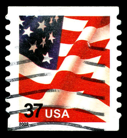 postmarked: UNITED STATES OF AMERICA - CIRCA 2002: A used postage stamp from the United States of America, featuring an illustration of the Stars and Stripes of the American flag, circa 2002.