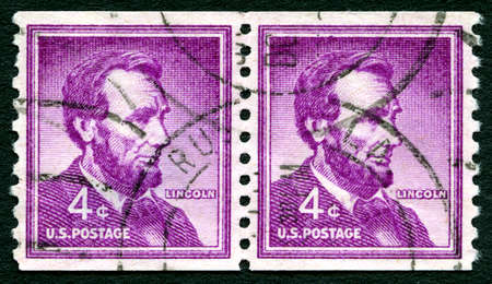 abraham lincoln: UNITED STATES OF AMERICA - CIRCA 1954: A used postage stamp from the USA depicting an illustration of historic American President Abraham Lincoln, circa 1954. Editorial