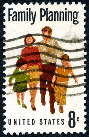 family planning: UNITED STATES OF AMERICA - CIRCA 1967: A used postage stamp from the USA depicting a message of Family Planning, circa 1967. Editorial