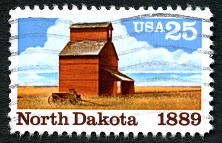 statehood: UNITED STATES OF AMERICA - CIRCA 1989: A used US Postage Stamp commemorating the 100th Anniversary of North Dakota statehood, circa 1989.