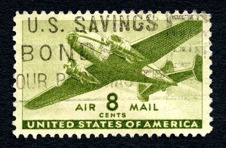 air mail: UNITED STATES OF AMERICA - CIRCA 1944: A used Air Mail postage stamp from the United States of America, picturing a transport aircraft, circa 1944. Editorial