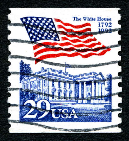 postmarked: UNITED STATES OF AMERICA - CIRCA 1992: A postage stamp printed in the United States, features waving US flag and the White House, circa 1992