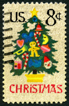 postage: UNITED STATES OF AMERICA - CIRCA 1973: A used postage stamp from the USA celebrating Christmas, circa 1973.