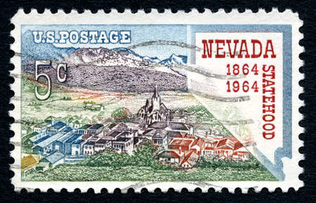 postmarked: UNITED STATES OF AMERICA - CIRCA 1964: A used postage stamp from the USA, celebrating the 100th Anniversary of Nevada Statehood, circa 1964.