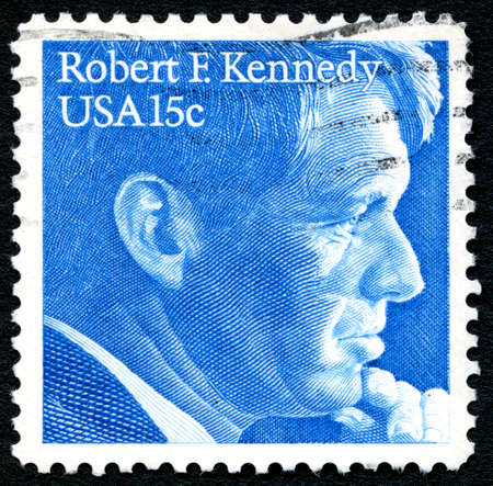 postmarked: UNITED STATES OF AMERICA - CIRCA 1979: A used postage stamp from the USA depicting an illustration of Robert F. Kennedy, circa 1979.
