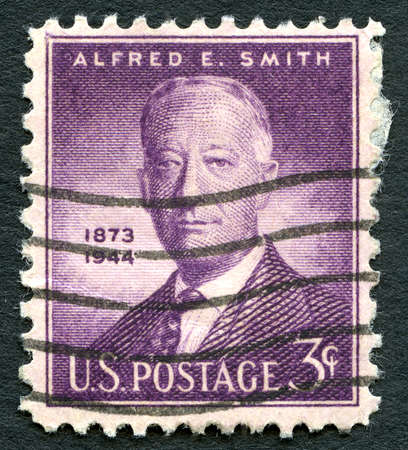 statesman: UNITED STATES OF AMERICA - CIRCA 1945: A used US postage stamp with a portrait of historic American statesman Alfred E. Smith, circa 1945.