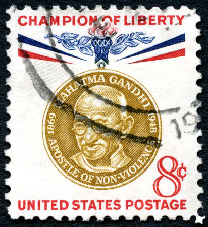 non violence: UNITED STATES OF AMERICA - CIRCA 1961: A used postage stamp from the USA, celebrating the life of Mahatma Gandhi - a Champion of Liberty, circa 1961. Editorial