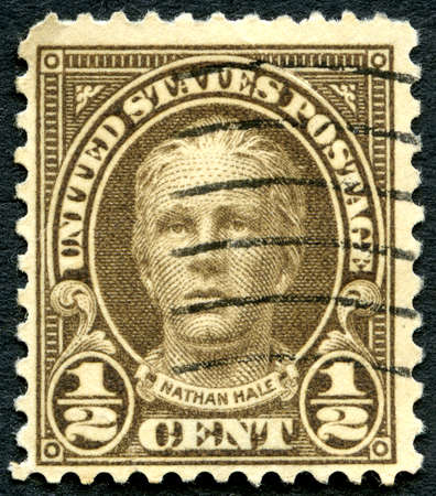 postmarked: UNITED STATES OF AMERICA - CIRCA 1925: A used postage stamp from the USA featuring an illustration of Nathan Hale, circa 1925. Hale was an American soldier and spy for the Continental Army during the American Revolutionary War.