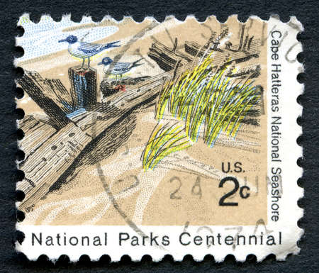hatteras: UNITED STATES OF AMERICA - CIRCA 1972: A used postage stamp from the USA depicting an illustration of Cape Hatteras National Seashore in North Carolina, circa 1972. Editorial
