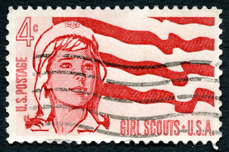 postmarked: UNITED STATES OF AMERICA - CIRCA 1962: A used postage stamp from the USA, celebrating Girl Scouts, circa 1962.