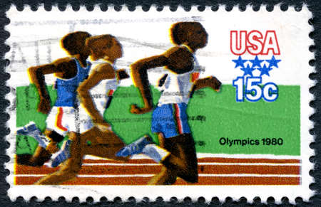 the olympic games: UNITED STATES OF AMERICA - CIRCA 1980: A used postage stamp from the USA illustrating an Athletics scene and commemorating the 1980 Olympic Games, circa 1980. Editorial