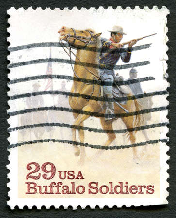 postmarked: UNITED STATES OF AMERICA - CIRCA 1994: A used postage stamp from the USA commemorating Buffalo Soldiers, circa 1994.