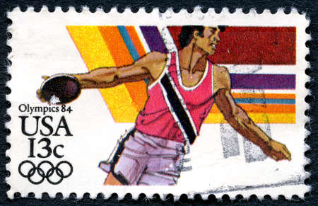 olympiad: UNITED STATES OF AMERICA - CIRCA 1984: A used postage stamp from the USA depicting an illustration of the Discus sport event and promoting the 1984 Olympic Games, circa 1984.