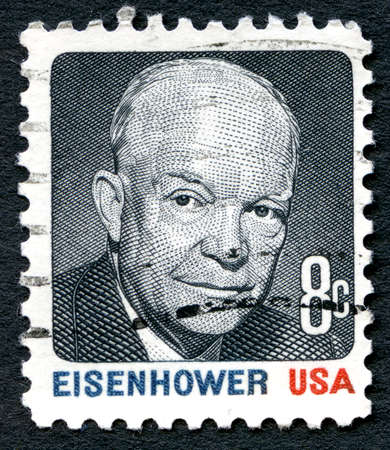 eisenhower: UNITED STATES OF AMERICA - CIRCA 1980: A used postage stamp from the USA depicting an illustration of former President Dwight D. Eisenhower, circa 1980.