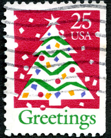 postage: UNITED STATES OF AMERICA - CIRCA 1990: A used postage stamp from the USA depicting an illustration of Christmas Tree, circa 1990.