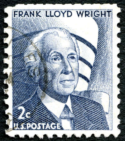 postmarked: UNITED STATES OF AMERICA - CIRCA 1966: A used postage stamp from the USA depicting a portrait of famous architect Frank Lloyd Wright, circa 1966.