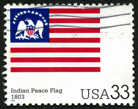 indian postal stamp: UNITED STATES OF AMERICA - CIRCA 2000: A used postage stamp from the USA depicting an illustration of the Indian Peace Flag, circa 2000.