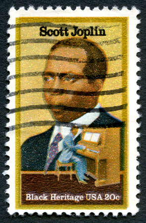 postmarked: UNITED STATES OF AMERICA - CIRCA 1983: A used postage stamp from the USA, depicting an illustration of famous composer and pianist Scott Joplin, circa 1983.