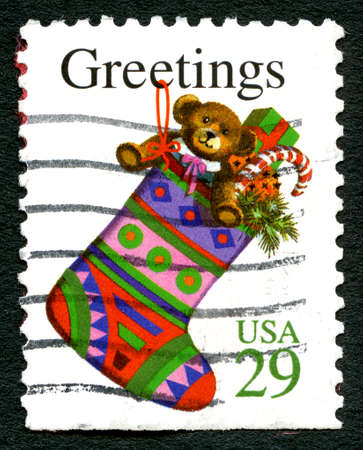 postage: UNITED STATES OF AMERICA - CIRCA 1993: A used postage stamp from the USA, wishing Christmas Greetings and an illustration of a Christmas Stocking, circa 1993. Editorial