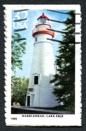 postmarked: UNITED STATES OF AMERICA - CIRCA 1995: A used postage stamp from the USA depciting an illustration of Marblehead Lighthouse on Lake Eerie, circa 1995.