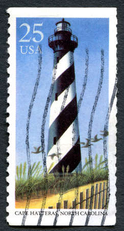 hatteras: UNITED STATES OF AMERICA - CIRCA 1990: A used postage stamp from the USA, depicting an illustration of Cape Hatteras Lighthouse in North Carolina, circa 1990. Editorial
