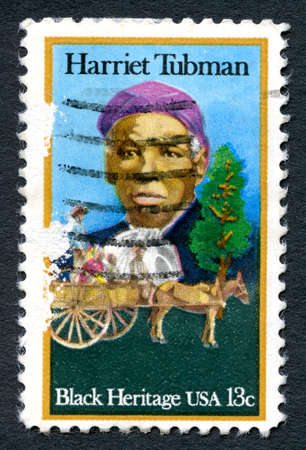 abolitionist: UNITED STATES OF AMERICA - CIRCA 1996: A used postage stamp from the USA, depicting an illustration of famous abolitionist and humanitarian Harriet Tubman, circa 1996.