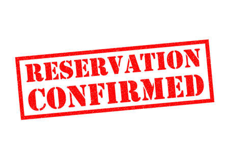 confirmed: RESERVATION CONFIRMED red Rubber Stamp over a white background.