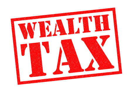 WEALTH TAX red Rubber Stamp over a white background. Stock Photo