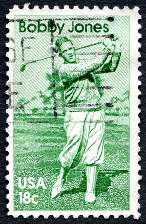 bobby: UNITED STATES OF AMERICA - CIRCA 1981: A used postage stamp from the USA celebrating the life of famous golfer Bobby Jones, circa 1981.