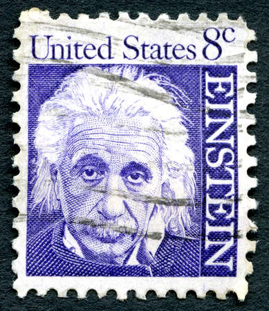 physicist: UNITED STATES OF AMERICA - CIRCA 1965: A used postage stamp from the USA, depicting a portrait of famous physicist Albert Einstein, circa 1965. Editorial