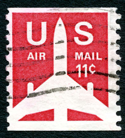 air mail: UNITED STATES OF AMERICA - CIRCA 1971: A used Air Mail postage stamp from the USA, depicting an illustration of an aircraft, circa 1971.