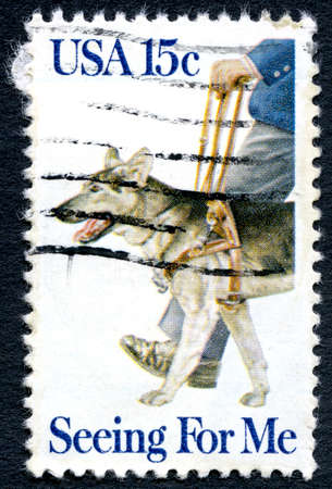 mail me: UNITED STATES OF AMERICA - CIRCA 1979: A used postage stamp from the USA, depicting an illustration of a Guide Dog for the Blind, circa 1979. Editorial