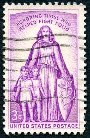 honoring: UNITED STATES OF AMERICA - CIRCA 1957: A used postage stamp from the USA, honoring those who have helped fight Polio, circa 1957.