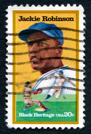 baseman: UNITED STATES OF AMERICA - CIRCA 1982: A used postage stamp from the USA, celebrating black heritage depicting an illustration of famous Baseball player Jackie Robinson, circa 1982.