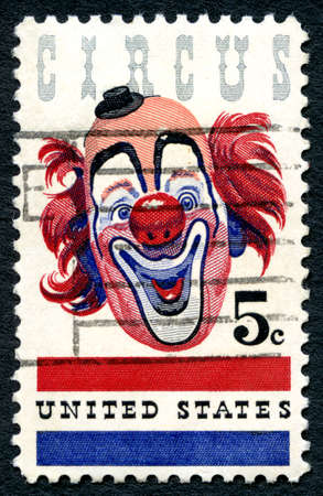 clowning: UNITED STATES OF AMERICA - CIRCA 1966: A used postage stamp from the USA, celebrating the American Circus by depicting an illustration of a Clown, circa 1966.
