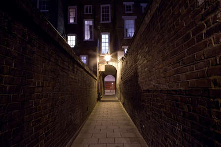 ripper: A night-time view of an eerie urban alleyway. Stock Photo