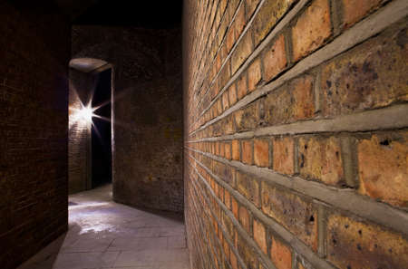 A night-time view of an eerie urban alleyway. Stock Photo