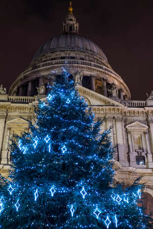 st pauls: A view of a festive Christmas tree with St. Pauls Cathedral in the background, London.