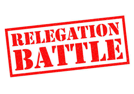 demotion: RELEGATION BATTLE red Rubber Stamp over a white background. Stock Photo