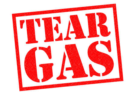 rioting: TEAR GAS red Rubber stamp over a white background. Stock Photo