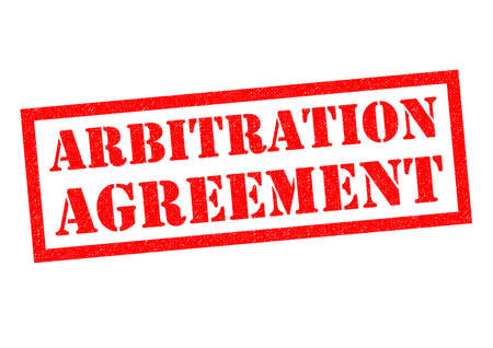 disagreed: ARBITRATION AGREEMENT red Rubber Stamp over a white background.