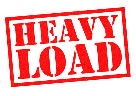 hefty: HEAVY LOAD red Rubber Stamp over a white background. Stock Photo