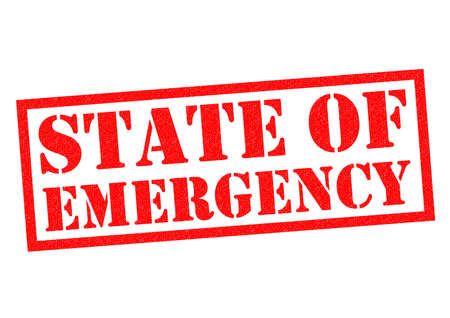 warned: STATE OF EMERGENCY red Rubber Stamp over a white background.