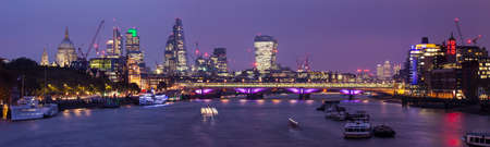 A beautiful panoramic view taking in sights including St. Pauls Cathedral, the skyscrapers of the City of London, Docklands, Oxo Tower and the River Thames in London. Stock Photo